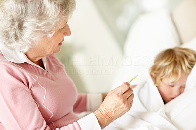 Buy stock photo Portrait of a sad mature woman reading temperature of a sick child