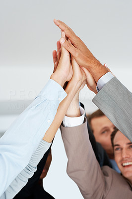Buy stock photo Pile of hands - Successful business team celebrating their success with a high five