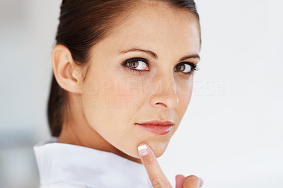 Buy stock photo Closeup of beautiful young woman thinking about something with finger on her chin