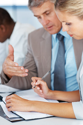 Buy stock photo Busy senior manager guiding his colleague on a new business project at office