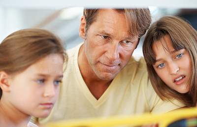 Buy stock photo Closeup of a family looking at the reading displayed on the digital angle measurer in confusion