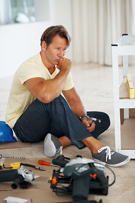 Buy stock photo Full length of man looking at the angle of wooden board and planning