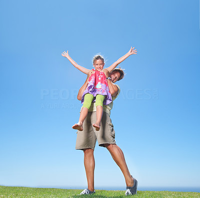 Buy stock photo Full length of father lifting his daughter and smiling