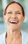 Closeup of a happy mature brunette woman laughing