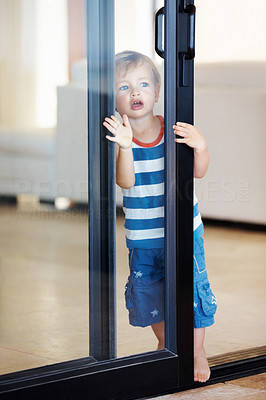 Buy stock photo Full length of cute kid looking through glass door