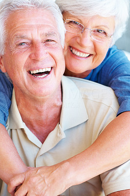 Buy stock photo Closeup portrait of cheerful senior couple smiling with woman embracing man from behind
