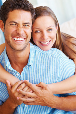 Buy stock photo Portrait of cute couple smiling with woman embracing man from behind