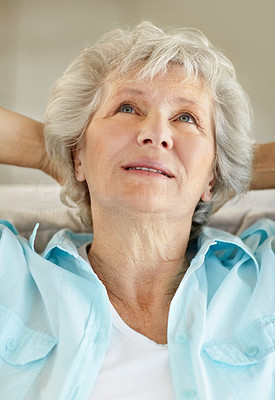 Buy stock photo Closeup of a thoughtful senior woman with looking upwards with her hands behind her head