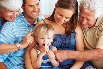 Buy stock photo Family having fun with young kid eating watermelon