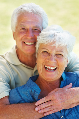 Buy stock photo Closeup portrait of senior couple smiling with man embracing woman from behind