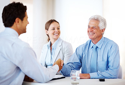 Buy stock photo Portrait of a happy business men shaking hands during a meeting at office