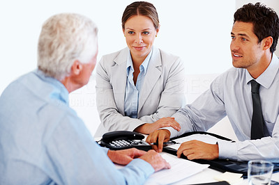 Buy stock photo Portrait of a business young couple talking to financial advisor at office desk