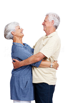 Buy stock photo Portrait of a happy retired old couple hugging and looking at eachother isolated against white background