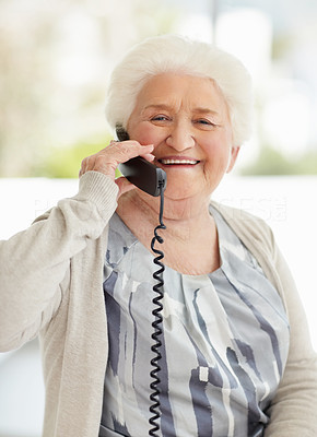 Buy stock photo Portrait of a happy senior woman talking on the telephone