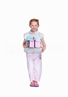 Buy stock photo Full length portrait of a happy small girl holding a pile of gifts, isolated on white background - copyspace