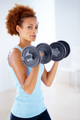 Buy stock photo Portrait of a beautiful  black young woman lifting dumbbells and smiling at gym - Heavy weightlifting