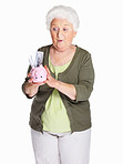 Surprise mature woman holding piggy bank isolated on white