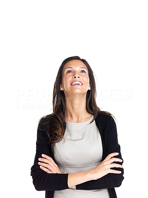 Buy stock photo Pretty young woman standing with hands folded looking up at copyspace against white background
