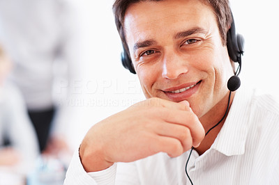 Buy stock photo Closeup of handsome business man wearing headset and smiling- copyspace