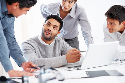 Buy stock photo Leader discussing project with his team on laptop during meeting
