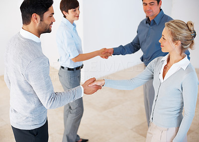 Buy stock photo Row of business people handshaking with each other