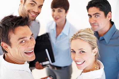Buy stock photo Closeup of successful business people looking at you and smiling