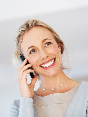 Buy stock photo Closeup of happy business woman having friendly conversation on cellphone