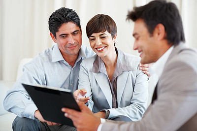 Buy stock photo Business consultant showing new investment plans to couple
