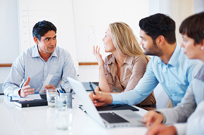 Buy stock photo Male executive discussing project with colleagues in a meeting