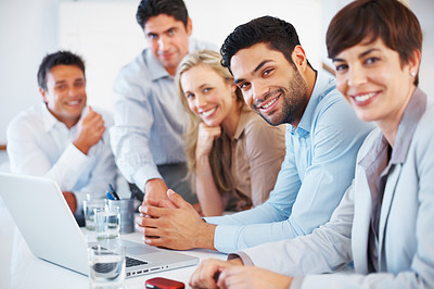 Buy stock photo Portrait of business people smiling at meeting with focus on handsome executive