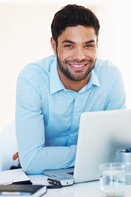 Buy stock photo Portrait of smart business man sitting at table with laptop and smiling