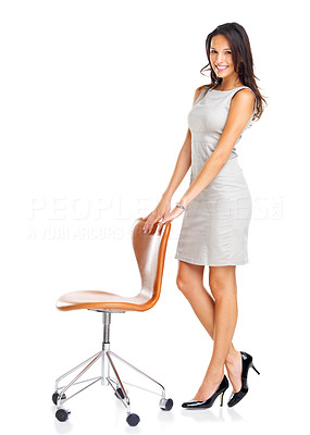 Buy stock photo Pretty happy young woman standing with a chair isolated on white background