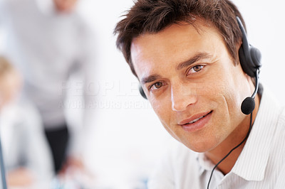 Buy stock photo Closeup of smart business man wearing headset with colleagues in background