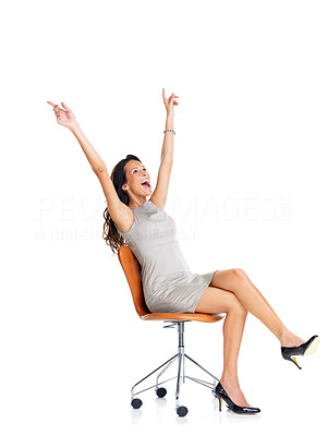 Buy stock photo Pretty excited young woman sitting on chair celebrating victory - Isolated on white background