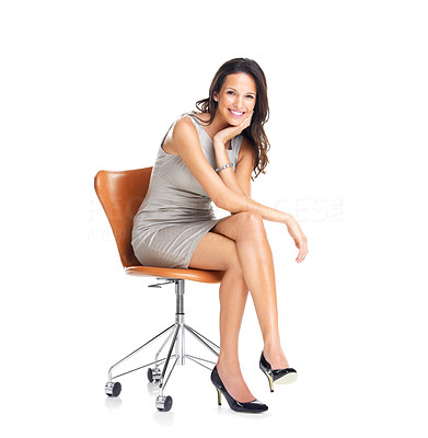 Buy stock photo Gorgeous young woman sitting on a chair isolated over white background