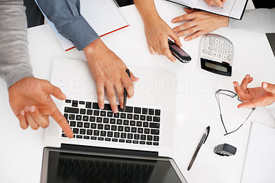 Buy stock photo Cropped image of business people discussing work on laptop