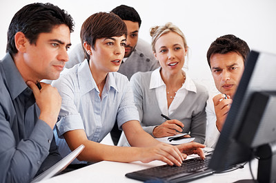 Buy stock photo Group of business people working together on computer during meeting