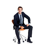 Successful young male business executive sitting on a chair