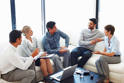 Buy stock photo Group of business people having discussion on project during meeting