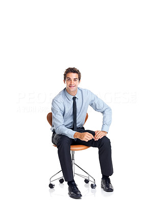 Buy stock photo Smart young male exceutive sitting on chair smiling against white background