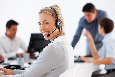 Buy stock photo Smiling customer care representative with colleagues in background