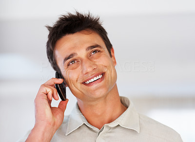 Buy stock photo Closeup of smiling male executive using cellphone and looking away - copyspace