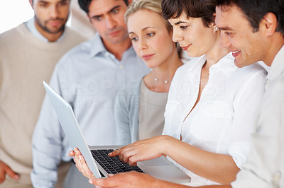 Buy stock photo Successful business team reviewing project on laptop