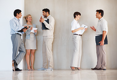 Buy stock photo Full length of business group conversing with each other