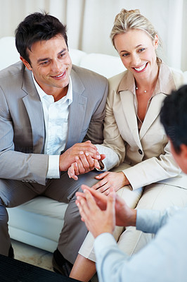 Buy stock photo Happy couple discussing future plans with financial advisor during meeting