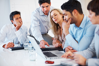 Buy stock photo Male executive sitting on table and discussing with colleagues during meeting