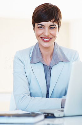 Buy stock photo Portrait of attractive female executive with laptop sitting at her desk