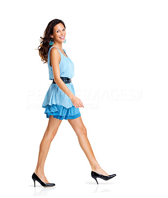 Buy stock photo Beautiful young woman in blue dress doing catwalk on white background - Copyspace
