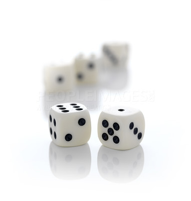 Buy stock photo Two rolling dices with three dices in background on white