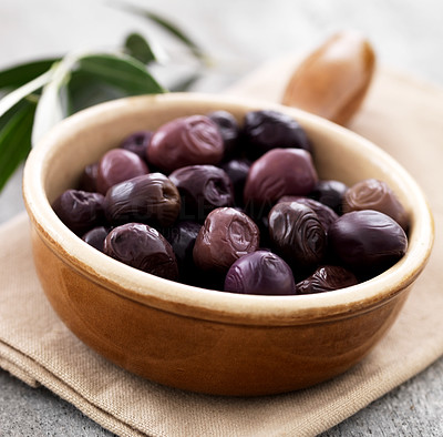 Buy stock photo Closeup of tasty dried black olives in a wooden bowl